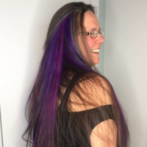 Linda Zukowski, owner, with purple hair